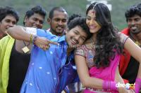 Vijay Anushka in Vettaikaran Tamil Movie songs Photos